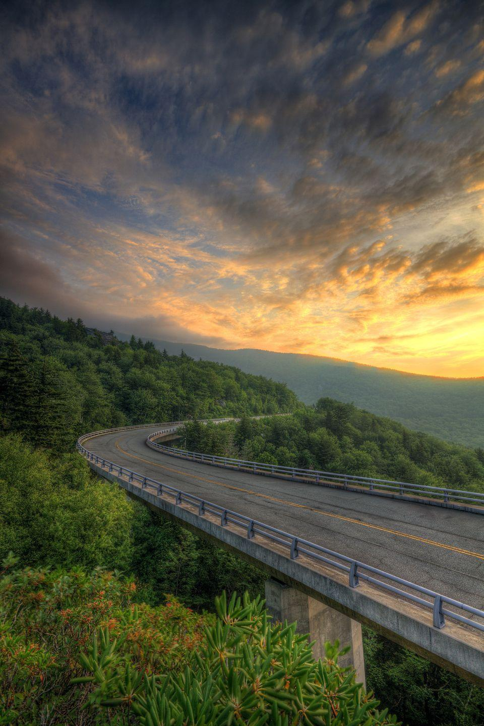 "<p><strong>Where: </strong>Blue Ridge Parkway, North Carolina and Virginia</p><p><strong>Why We Love It: </strong><a href=""https://www.countryliving.com/life/travel/g4454/most-scenic-drives-in-america/"" rel=""nofollow noopener"" target=""_blank"" data-ylk=""slk:This stretch of road"" class=""link rapid-noclick-resp"">This stretch of road</a> that meanders 469 miles through the Appalachian Mountains is the most visited place in the U.S. National Park Service.</p>"