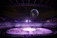 <p>TOKYO, JAPAN - JULY 23: A drone display is seen over the top of the stadium during the Opening Ceremony of the Tokyo 2020 Olympic Games at Olympic Stadium on July 23, 2021 in Tokyo, Japan. (Photo by Leon Neal/Getty Images)</p>