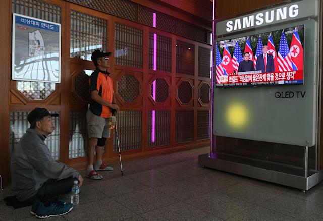 <p>People watch a television news screen showing the summit between US President Donald Trump and North Korean leader Kim Jong Un in Singapore, at a railway station in Seoul on June 12, 2018. – Donald Trump and Kim Jong Un have become on June 12 the first sitting US and North Korean leaders to meet, shake hands and negotiate to end a decades-old nuclear stand-off. (Photo by Jung Yeon-je/AFP/Getty Images) </p>