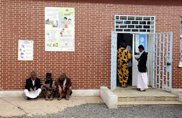 <p>Yemenis wait for their children suspected of being infected with cholera receiving treatment at a hospital in Sana'a, Yemen on June 15, 2017. (Yahya Arhab/EPA/REX/Shutterstock) </p>