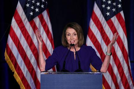 FILE PHOTO: U.S. House Minority Leader Nancy Pelosi reacts to the results of the U.S. midterm elections at a Democratic election night rally and party in Washington, U.S. Nov. 6, 2018. REUTERS/Jonathan Ernst/File Photo