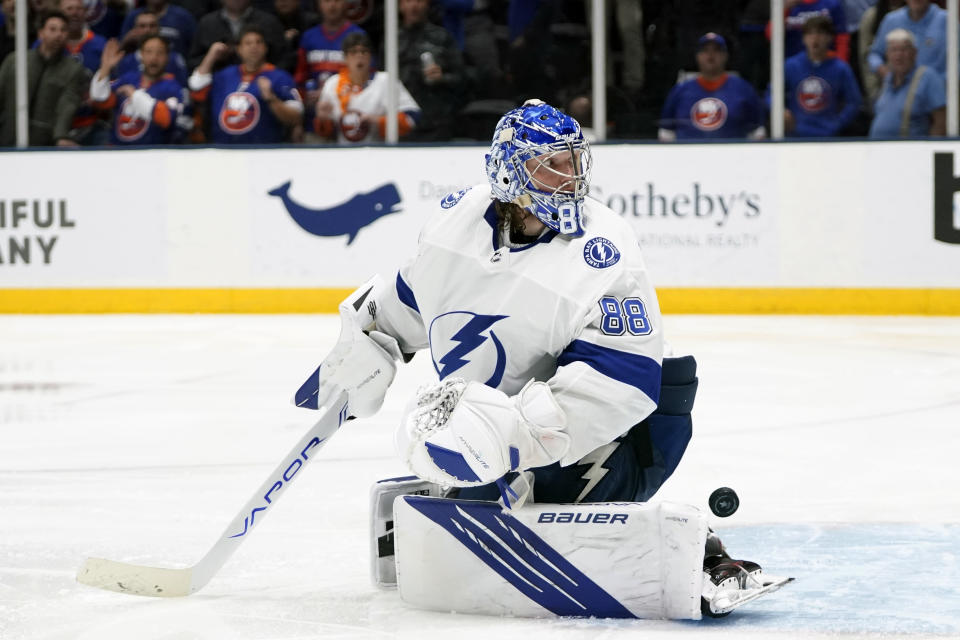 Fans cheer as Tampa Bay Lightning goaltender Andrei Vasilevskiy (88) reacts after New York Islanders' Anthony Beauvillier scored a goal during the overtime period of Game 6 of an NHL hockey semifinals Wednesday, June 23, 2021, in Uniondale, N.Y. The Islanders won 3-2. (AP Photo/Frank Franklin II)