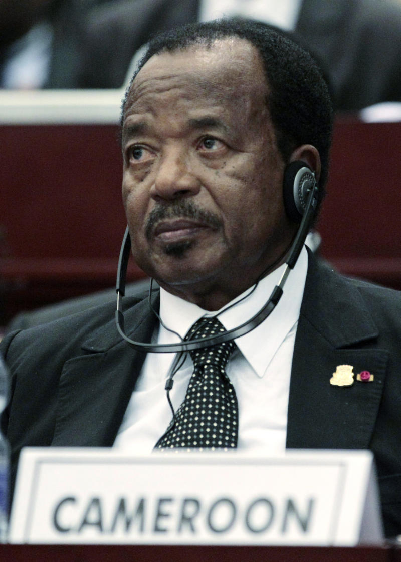 FILE-In this Thursday, June 30, 2011, file photo Cameroon President Paul Biya listens during a session on the 17th African Union Summit theme of youth empowerment, at the Sipopo Conference Center, outside Malabo, Equatorial Guinea.  Cameroon's 79-year-old President Paul Biya marks 30-years in office on Tuesday, Nov. 6, 2012,  and the ruling party planned boisterous celebrations while banning the opposition from holding a protest.(AP Photo/Rebecca Blackwell, File)