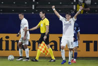 Los Angeles Galaxy's Cristian Pavon (10) celebrates after a 1-0 win over the Vancouver Whitecaps in an MLS soccer match, Sunday, Oct. 18, 2020, in Carson, Calif. (AP Photo/Marcio Jose Sanchez)