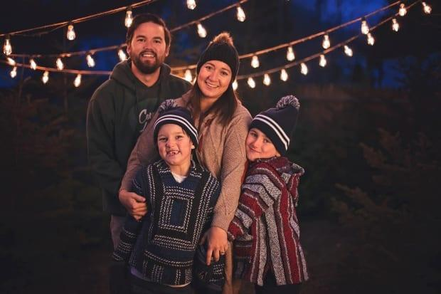 Devin Ward, with wife Kayla and their sons, Dexter, left, and Jackson. Ward co-owns a dispensary on the Eel Ground First Nation and said Monday night that the dispensary will be dropping all products whose packaging mimics brands known to children.
