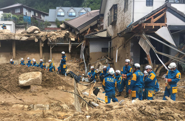 <p>Emergency teams rest outside of structural damage caused by heavy rains, July 9, 2018, in Hiroshima, Japan. (Photo: Haruka Nuga/AP) </p>