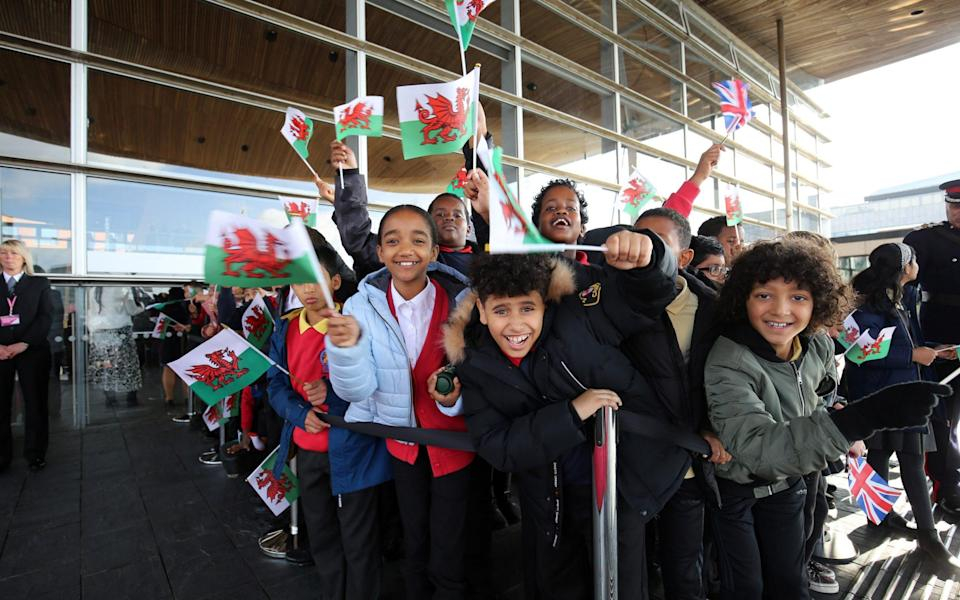 Children welcome the Queen to the opening of the Senedd in Cardiff - Gareth Everett/Huw Evans Picture Agency