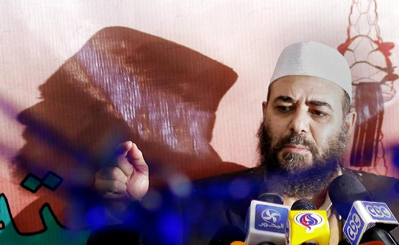 "Tarek el-Zomor leader and founder of the Building and Development Party, who was convicted with others of planning the assassination of late president Anwar in 1981, talks during a presser to celebrate the early results of an Islamist-backed constitution in Cairo, Egypt, Monday, Dec. 24, 2012. The Muslim Brotherhood, the main group backing the charter, claimed it passed with a 64 percent ""yes"" vote. The official results are expected on Monday, Dec. 24. (AP Photo/Amr Nabil)"