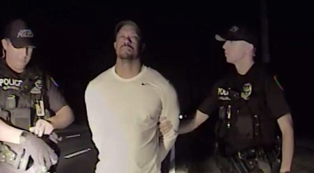 "<a class=""link rapid-noclick-resp"" href=""/pga/players/147/"" data-ylk=""slk:Tiger Woods"">Tiger Woods</a> is shown handcuffed in police dash cam video released on Wednesday. (Jupiter PD)"