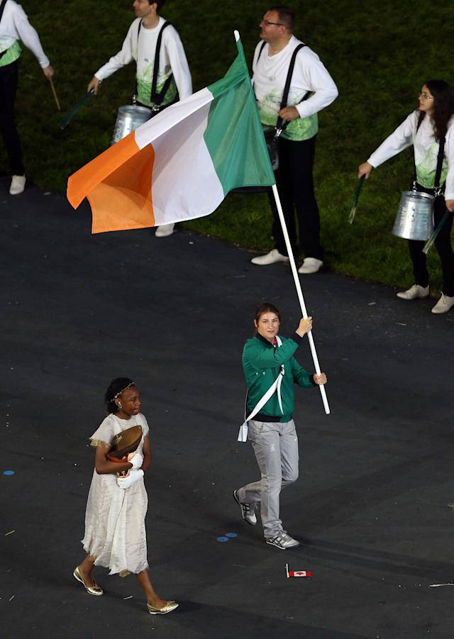 LONDON, ENGLAND - JULY 27: Katie Taylor of the Irland Olympic boxing team carries her country's flag during the Opening Ceremony of the London 2012 Olympic Games at the Olympic Stadium on July 27, 2012 in London, England. (Photo by Paul Gilham/Getty Images)