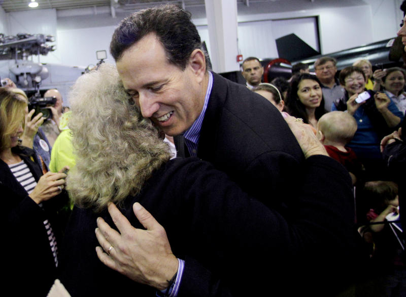 Republican presidential candidate, former Pennsylvania Sen. Rick Santorum hugs a supporter during a rally at Battleship Memorial Park, Friday, March 9, 2012, in Mobile, Alabama. (AP Photo/Eric Gay)