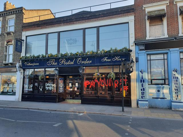 The windows of The Postal Order Wetherspoon pub in Crystal Palace, south London (Picture: SWNS)