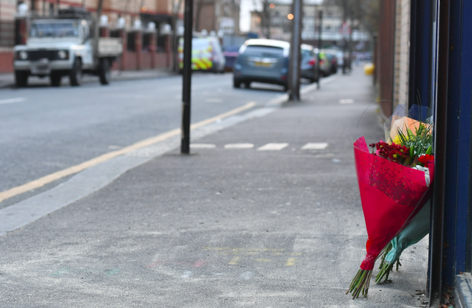 <em>Flowers have been left at the scene of the stabbing (PA)</em>