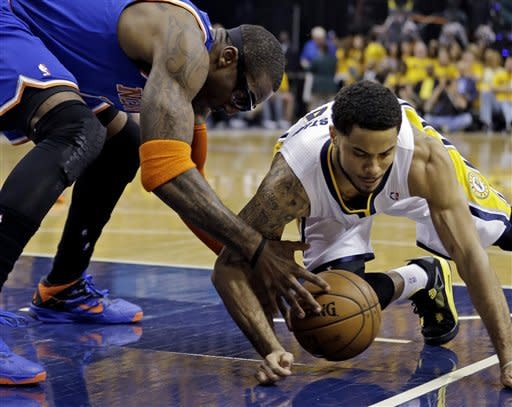 New York Knicks' Amare Stoudemire and Indiana Pacers' D.J. Augustin go after a loose ball during the first half of Game 6 of an Eastern Conference semifinal NBA basketball playoff series Saturday, May 18, 2013, in Indianapolis. (AP Photo/Darron Cummings)