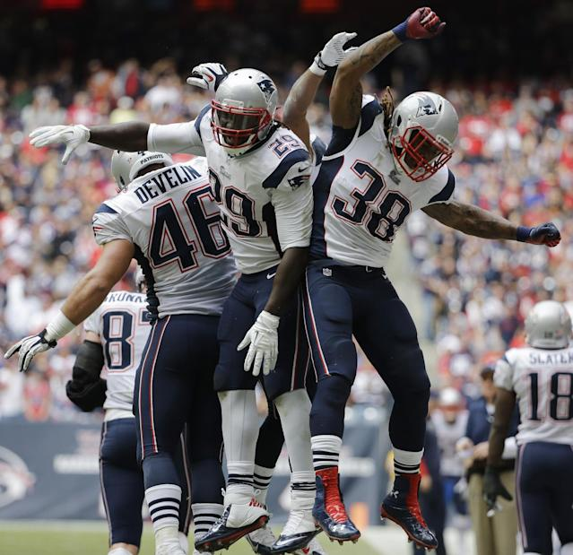 New England Patriots' LeGarrette Blount (29) celebrates with teammates James Develin (46) and Brandon Bolden (38) after scoring a touchdown against the Houston Texans during the fourth quarter of an NFL football game on Sunday, Dec. 1, 2013, in Houston. (AP Photo/David J. Phillip)