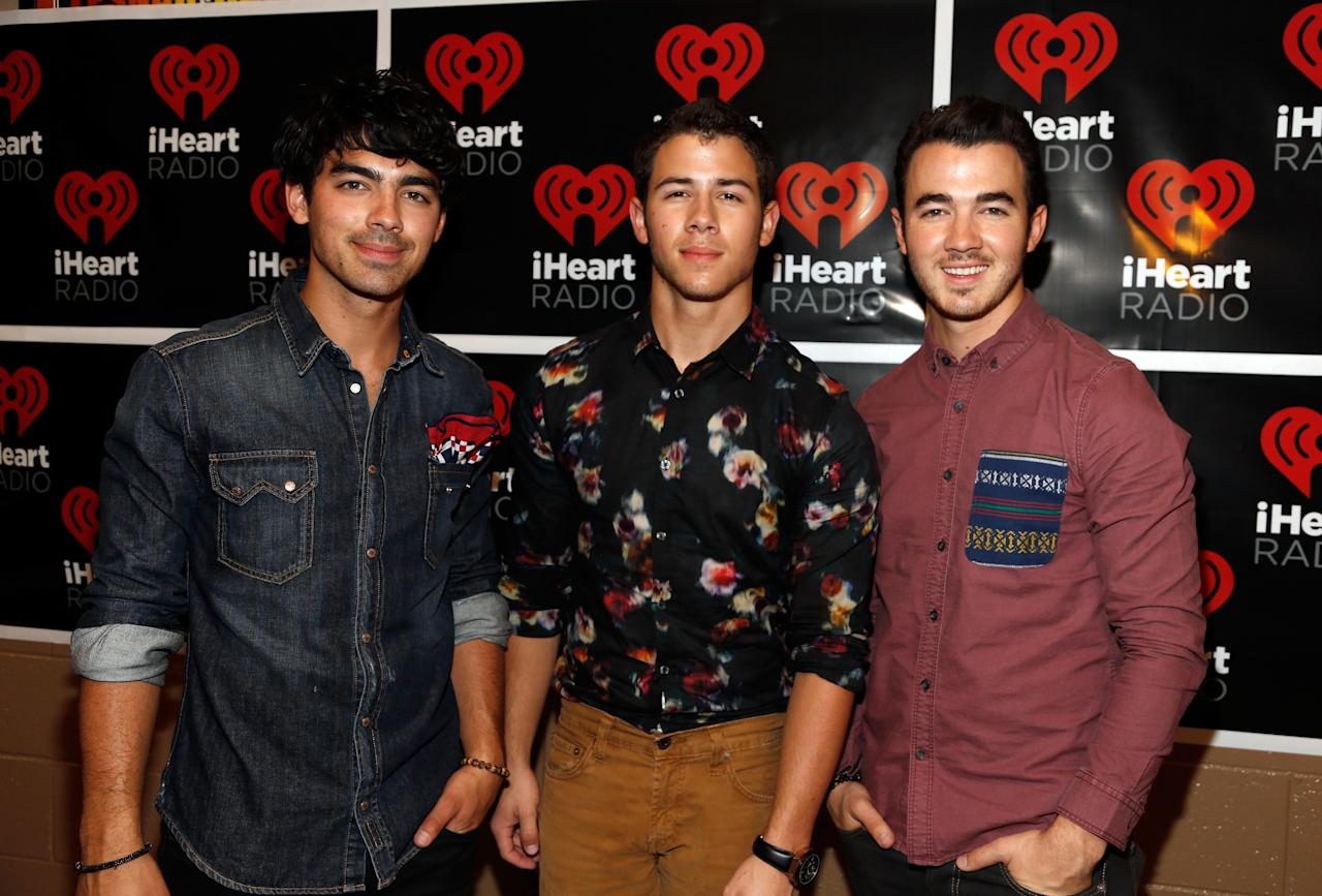 Singers Joe Jonas, Nick Jonas, and Kevin Jonas of The Jonas Brothers pose backstage during the 2012 iHeartRadio Music Festival at the MGM Grand Garden Arena on September 22, 2012 in Las Vegas, Nevada.  (Photo by Isaac Brekken/Getty Images for Clear Channel)