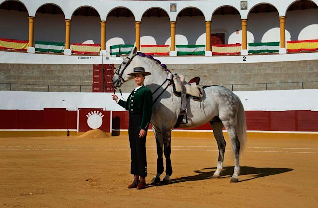 <p>French rejoneadora (mounted bullfighter who uses a lance) Lea Vincens, 33, poses at the Aracena bullring in Huelva, southern Spain, on February 25, 2018. (Photo: Cristina Quicler/AFP/Getty Images) </p>