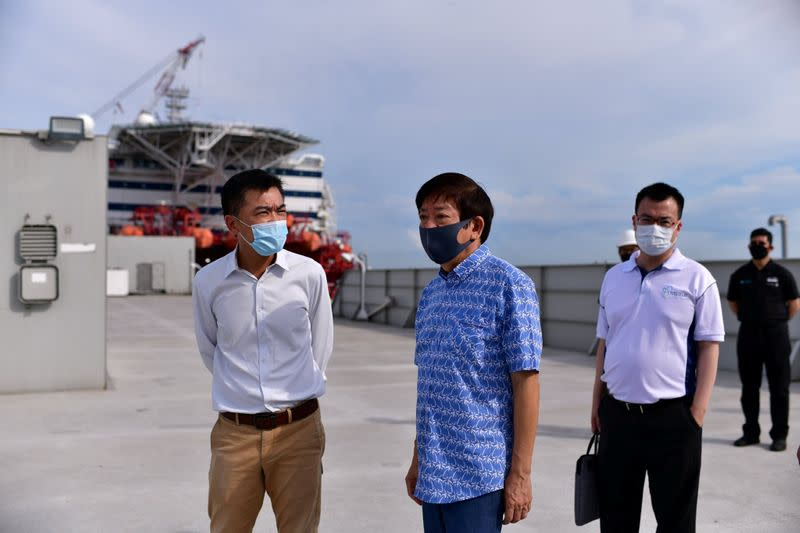Singapore's Transport Minister Khaw Boon Wan is seen onboard a floating accommodation docked at Tanjong Pagar Terminal, meant to house healthy migrant workers, as the spread of the coronavirus disease (COVID-19) continues in Singapore