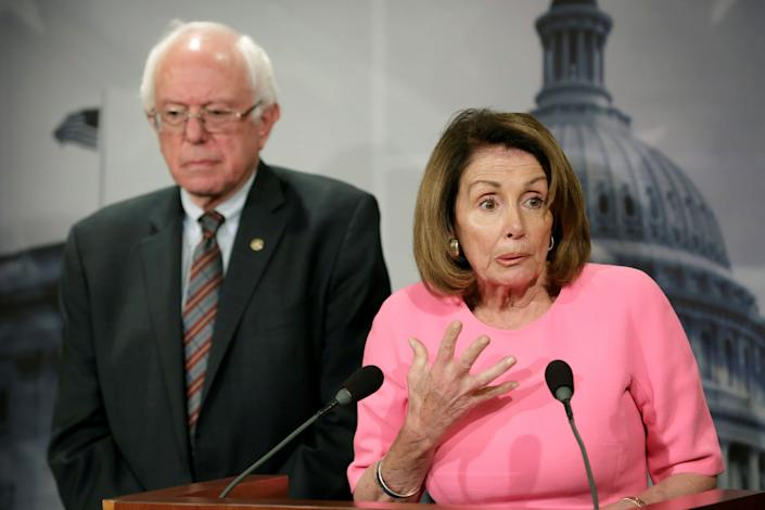 House Minority Leader Nancy Pelosi (D-Calif.) and Sen. Bernie Sanders (I-Vt.) hold a news conference on the release of the president's fiscal 2018 budget proposal on Capitol Hill on May 23, 2017.