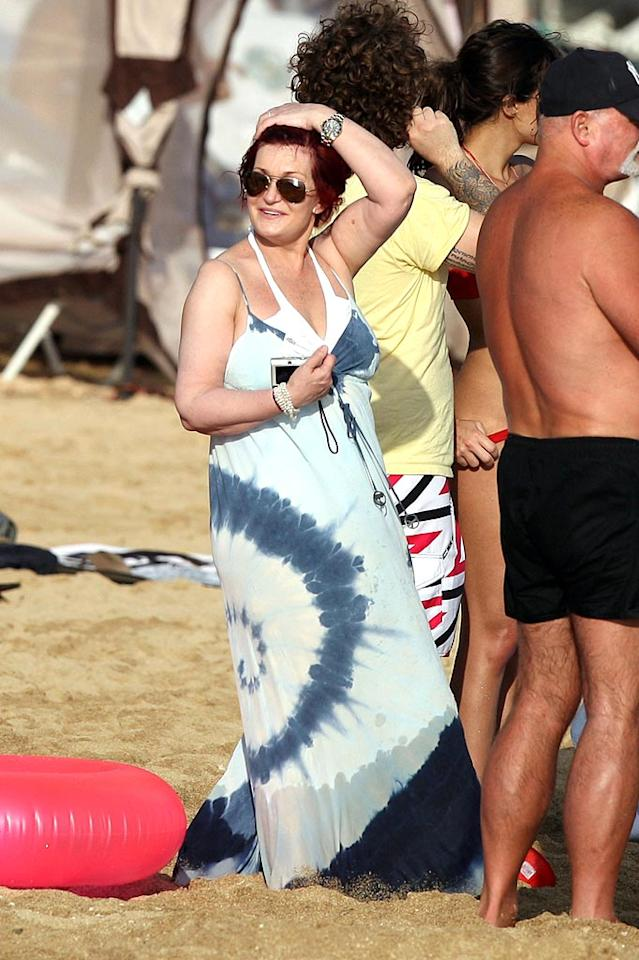 """Momma Sharon Osbourne relaxes on the beach after experiencing a somewhat controversial 2009. She caught heat for making fun of singing sensation Susan Boyle's looks on a radio show (Osbourne eventually apologized) and had to deal with the fallout from an on-camera fight with one of the contestants on her VH1 show """"Rock of Love Charm School."""" <a href=""""http://www. PacificCoastNews.com"""" target=""""new"""">PacificCoastNews.com</a> - January 4, 2010"""