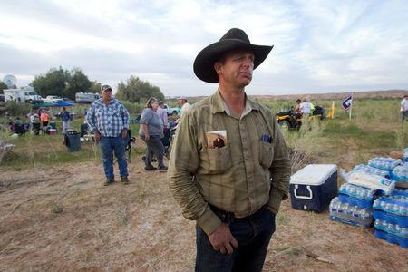 "FILE PHOTO:    Ryan Bundy (R), a son of rancher Cliven Bundy, attends a Bundy family ""Patriot Party"" near Bunkerville, Nevada, April 18, 2014.   REUTERS/Steve Marcus/File Photo"