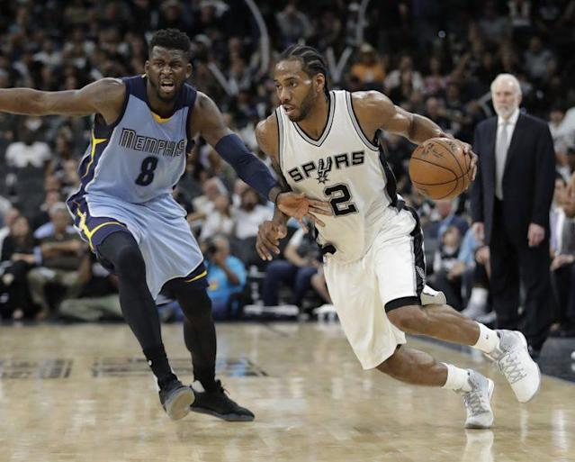 """<a class=""""link rapid-noclick-resp"""" href=""""/nba/players/4896/"""" data-ylk=""""slk:Kawhi Leonard"""">Kawhi Leonard</a> has been too much for the Grizzlies to handle in this series. (AP)"""
