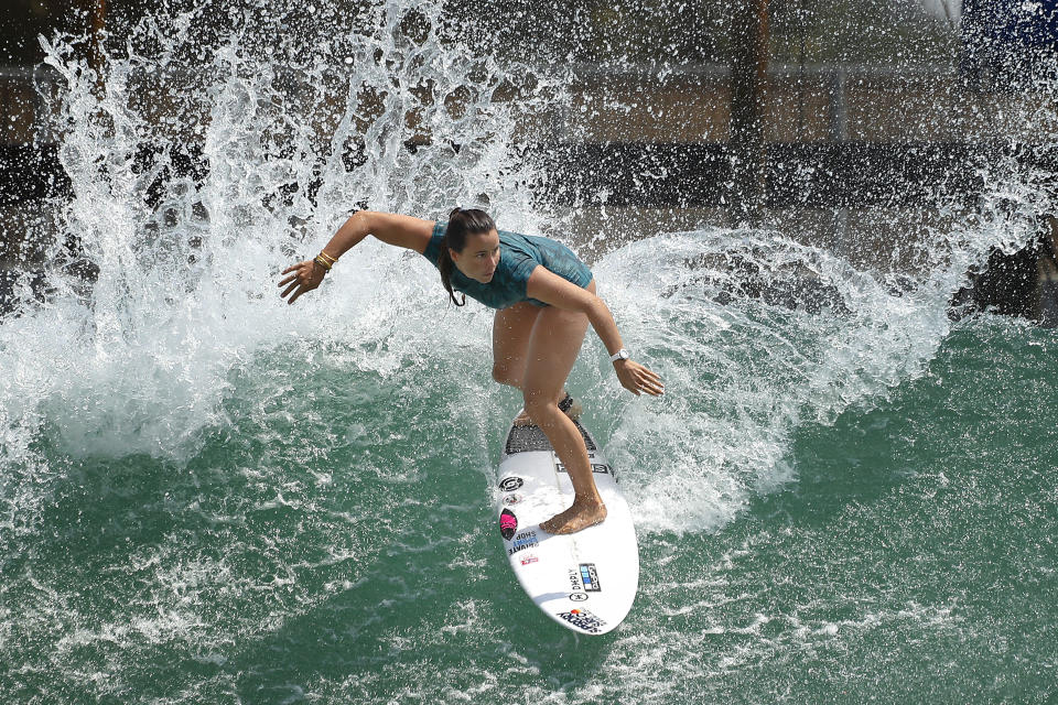 """Surfer Johanne Defay of France works out on a Surf Ranch wave during practice rounds for the upcoming Olympics Wednesday, June 16, 2021, in Lemoore, Calif. Defay wouldn't consider herself a poor surfer -- her father, after all, is a doctor, and the mega surfing brand, Roxy, started sponsoring her when she was 12, which included training opportunities in Australia and Hawaii. But the Reunion Island native recalls how devastating it was to her career when the sponsorship deal ended right before she reached the professional WSL championship tour in 2014. """"This is the sacrifice that I'm willing to do to be on the tour because it's my job, because it's my passion,"""" Defay said. """"I'm like trying to let the French surfers and the French girls know that it's possible. And maybe if we have more and more French (surfers)...then we have maybe more events there and maybe more support and maybe more sponsorship."""" (AP Photo/Gary Kazanjian)"""