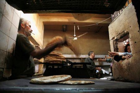 FILE PHOTO: People wait to buy bread inside a government bakery in Damascus, Syria, September 17, 2016. REUTERS/Omar Sanadiki/File Photo