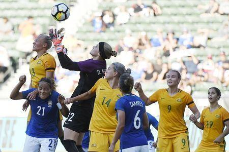 Aug 3, 2017; Carson, CA, USA; Brazil goalkeeper Dani Neuhaus (12) attempts to block a corner kick against Australia during the second half at StubHub Center. Australia won 6-1. Mandatory Credit: Kelvin Kuo-USA TODAY Sports