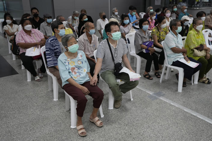 Residents wait for a dose of the AstraZeneca COVID-19 vaccine at the Central Vaccination Center in Bangkok, Thailand, Wednesday, July 14, 2021. Health authorities in Thailand said Wednesday they will seek to put limits on the export of locally produced AstraZeneca vaccine, as the country's supplies of COVID-19 vaccines are falling short of what is needed for its own population. (AP Photo/Sakchai Lalit)