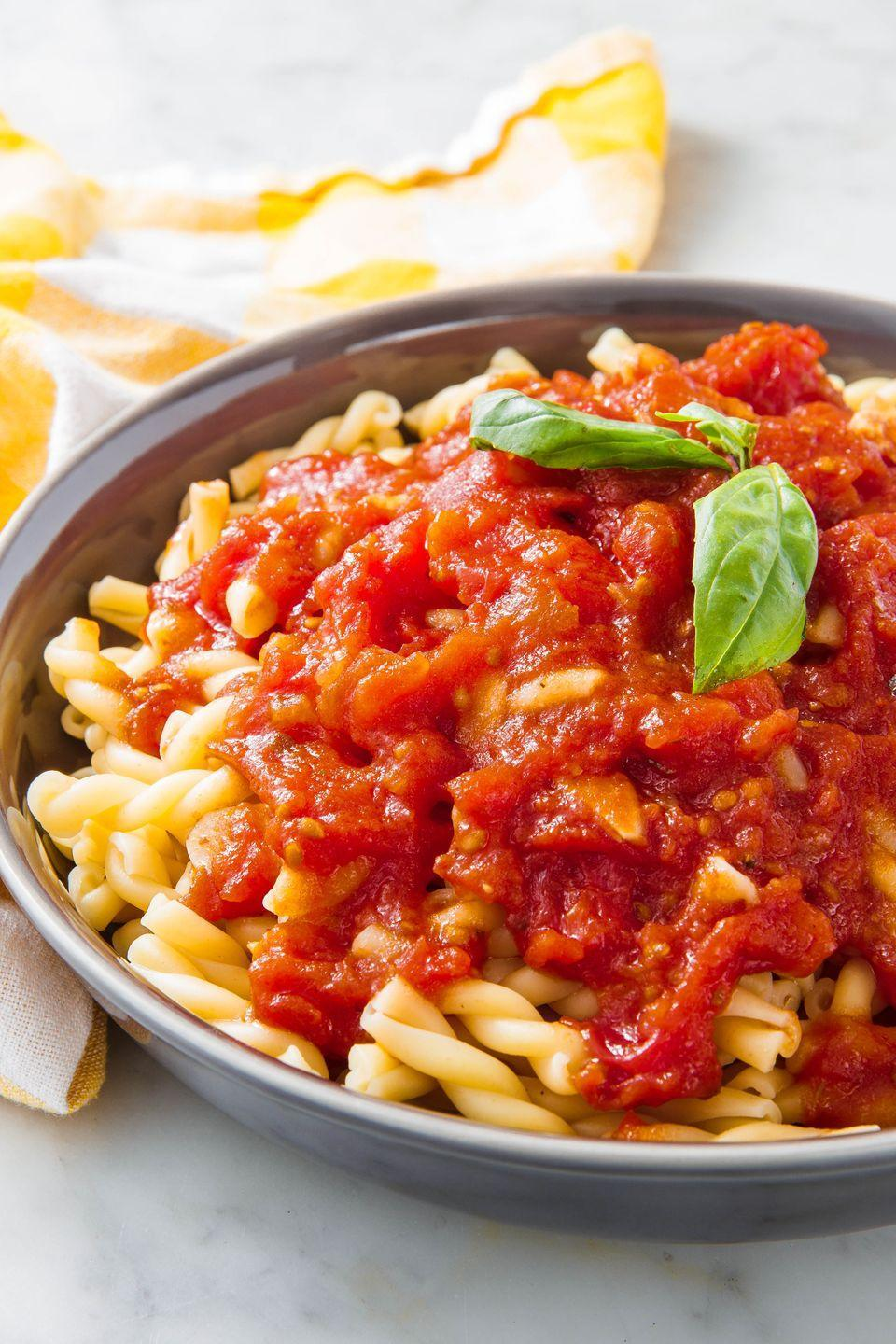 """<p>Don't forget to use whole tomatoes!</p><p>Get the recipe from <a href=""""https://www.delish.com/cooking/recipe-ideas/a24570093/marinara-sauce-recipe/"""" rel=""""nofollow noopener"""" target=""""_blank"""" data-ylk=""""slk:Delish"""" class=""""link rapid-noclick-resp"""">Delish</a>. </p>"""