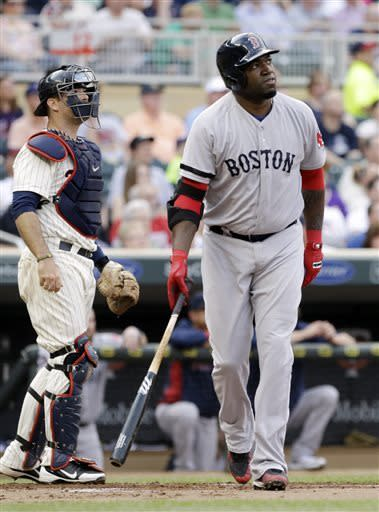 Boston Red Sox's David Ortiz watches his three-run home run off Minnesota Twins starting pitcher Scott Diamond in the first inning of a baseball game, Saturday, May 18, 2013, in Minneapolis. At left is Twins catcher Ryan Doumit. (AP Photo/Jim Mone)
