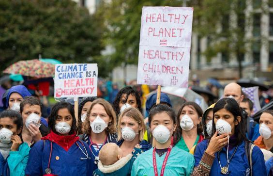 Doctors gather to protest in support of Extinction Rebellion at Jubilee Gardens, London, on 12 October 2019 (PA)