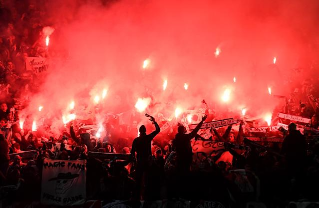 Objects such as flares have been thrown into the disabled supporters' section