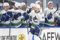 Vancouver Canucks' Tyler Graovac (44) celebrates a goal against the Edmonton Oilers during second-period NHL hockey game action in Edmonton, Alberta, Thursday, May 6, 2021.. (Jason Franson/The Canadian Press via AP)