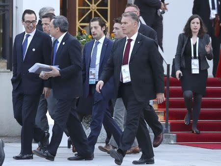 The President of the European Central Bank (ECB) Mario Draghi walks together with U.S. Treasury Secretary Steve Mnuchin during the G20 Finance Ministers and Central Bank Governors Meeting in Baden-Baden