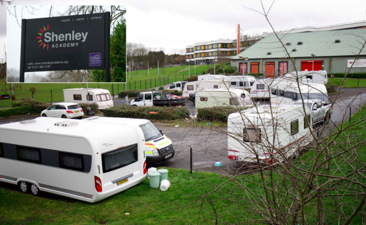 The travellers had parked a dozen caravans on the grounds of the Shenley Academy in Birmingham