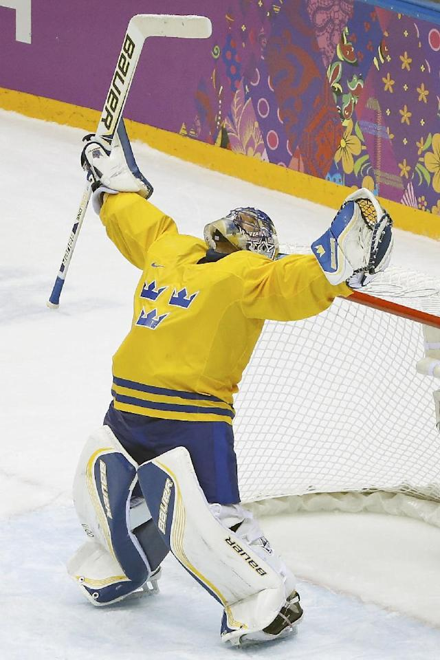 Sweden goaltender Henrik Lundqvist reacts to Swden's 2-1 victory over Findland in the men's semifinal ice hockey game at the 2014 Winter Olympics, Friday, Feb. 21, 2014, in Sochi, Russia. (AP Photo/Mark Humphrey)