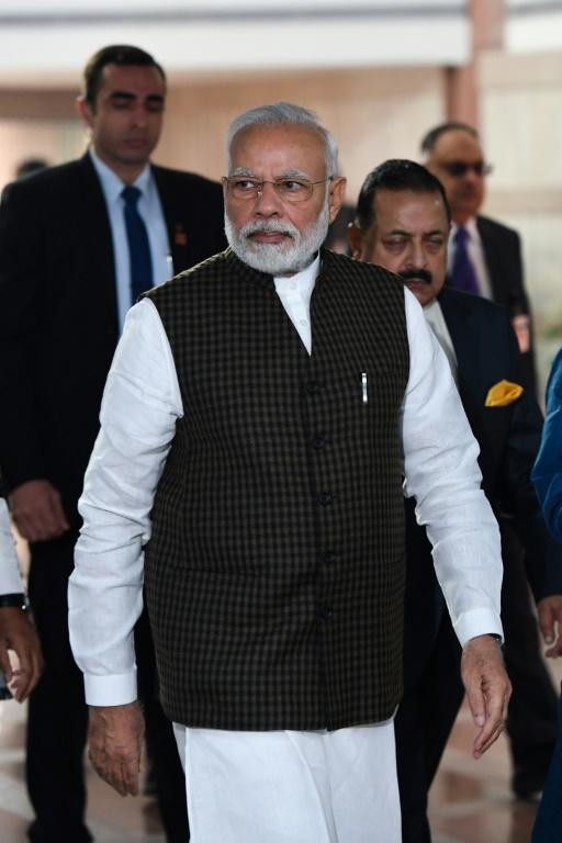 "India's Prime Minister Narendra Modi (C) blamed the opposition Congress party for ""spreading violence and creating an environment of fear"" by lying about the intent of the new citizenship law (AFP Photo/Prakash SINGH)"