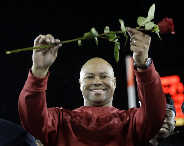 Stanford head coach David Shaw celebrates on the podium after 27-24 win over UCLA during the Pac-12 championship NCAA college football game in Stanford, Calif., Friday, Nov. 30, 2012. The Cardinal (11-2) will play the winner of the Big Ten title game between Nebraska and Wisconsin in the Rose Bowl on Jan. 1. (AP Photo/Marcio Jose Sanchez)