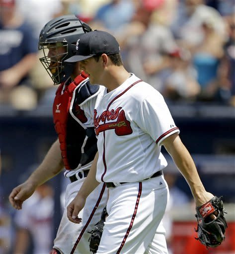 Atlanta Braves relief pitcher Cory Rasmus, right, walks off the field with catcher Evan Gattis after the Braves beat the Minnesota Twins 8-3 in a baseball game, Wednesday, May 22, 2013, in Atlanta. (AP Photo/David Goldman)