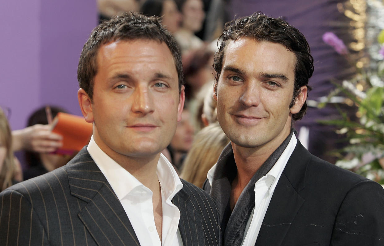 LONDON - MAY 7: Joel Beckett and Jake Maskell (R) arrive at the British Soap Awards 2005 at BBC Television Centre on May 7, 2005 in London, England. The annual awards recognise the best in British Soaps, with categories including Best Villain, Sexiest Male and Female, Best Actor and Actress and Best Soap. (Photo by Gareth Cattermole/Getty Images)
