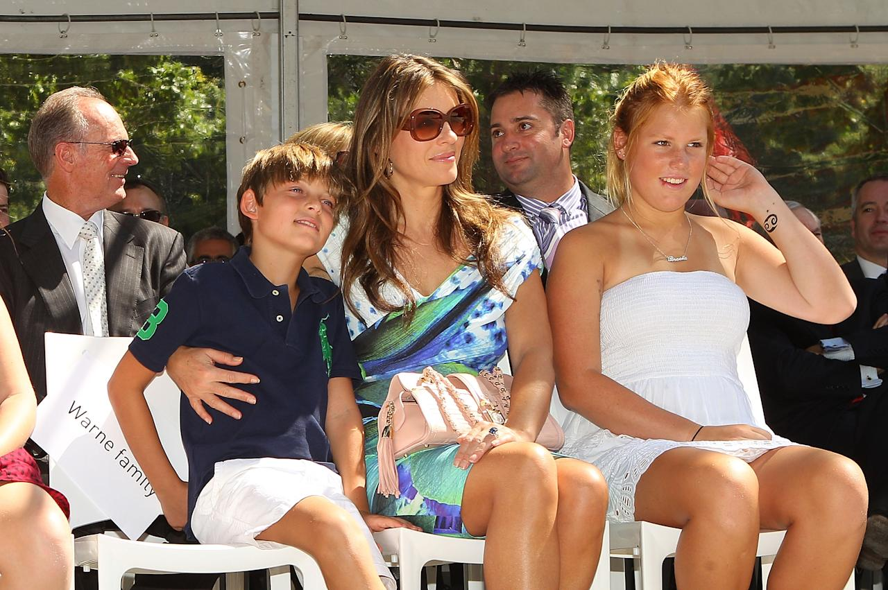 MELBOURNE, AUSTRALIA - DECEMBER 22:  (L to R) Keith Warne, Damian Hurley, Elizabeth Hurley and Brooke Warne look on during the unveiling of the Shane Warne statue at Melbourne Cricket Ground on December 22, 2011 in Melbourne, Australia.  (Photo by Scott Barbour/Getty Images)