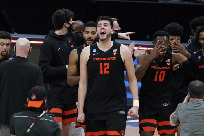 Oregon State center Roman Silva (12) celebrates after a Sweet 16 game against Loyola Chicago in the NCAA men's college basketball tournament at Bankers Life Fieldhouse, Saturday, March 27, 2021, in Indianapolis. Oregon State won 65-58. (AP Photo/Jeff Roberson)