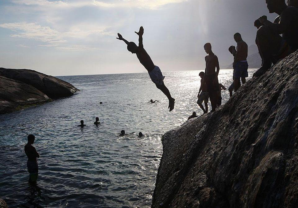 <p>Brazilians like to take it to the water. There's an annual tradition of jumping over seven waves (considered a lucky number) and making seven wishes for the new year.</p>
