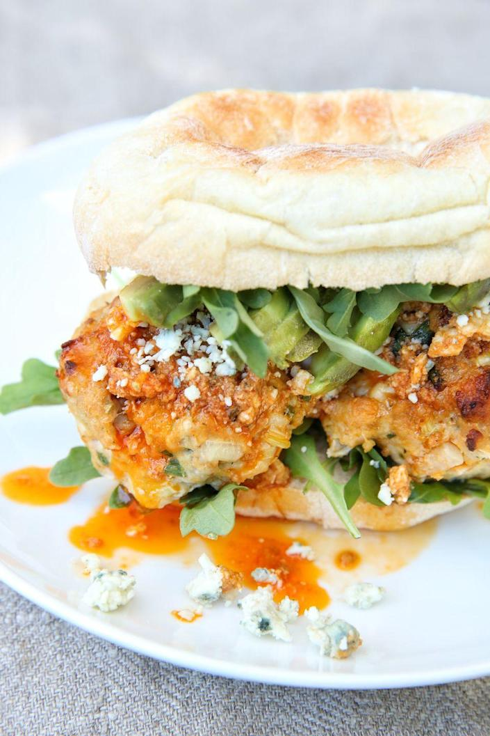 """<p>Switch up wing night with these spicy, saucy sandwiches.</p><p>Get the recipe from <a href=""""https://www.delish.com/cooking/recipe-ideas/recipes/a49220/buffalo-chicken-meatball-subs-recipe/"""" rel=""""nofollow noopener"""" target=""""_blank"""" data-ylk=""""slk:Delish"""" class=""""link rapid-noclick-resp"""">Delish</a>.</p>"""