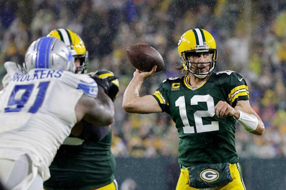 Aaron Rodgers bounced back from a torrid first game of the season to throw four touchdowns in a 35-17 win for the Green Bay Packers over the Detroit Lions (Mike Roemer/AP) (AP)