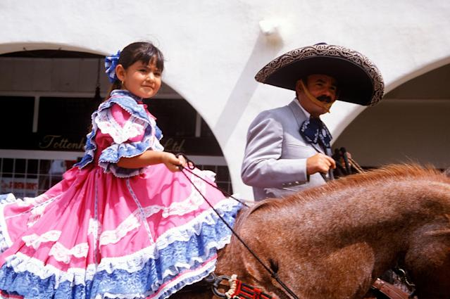 <p>Mexican-Americans participate in the July 4th Parade in Ojai, Calif., 2002. (Photo: Visions of America/UIG via Getty Images) </p>