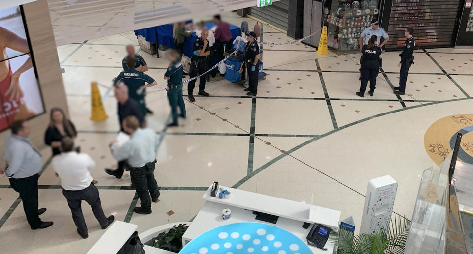 Police and emergency services gather at Cairns Central Shopping Centre after the attack. Source: QPS