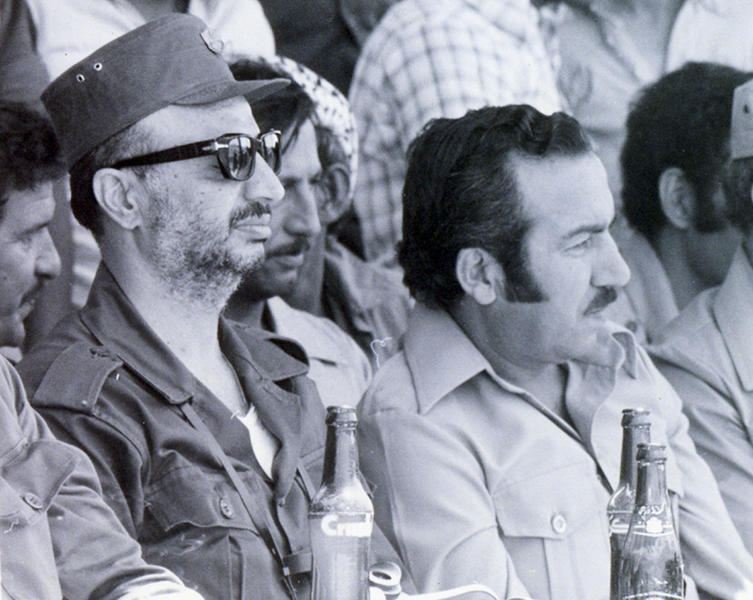 Undated file photograph of Palestinian leader Yasser Arafat, left, along with his deputy Abu Jihad, right, made available by the Palestinian Authority in Gaza City of the Gaza Strip. Lifting a nearly 25-year veil of secrecy, Israel acknowledged Thursday Nov 1 2012 that it killed the deputy of Palestinian leader Yasser Arafat in a 1988 seaborne raid on Tunisia. Israel has long been suspected of assassinating Khalil al-Wazir, who was better known by his nom de guerre Abu Jihad. But only now has the country's military censor cleared the Yediot Ahronot daily to publish the information, including an interview with the commando who killed him, at least 12 years after the newspaper got the information. (AP Photo/Palestinian Authority, File)